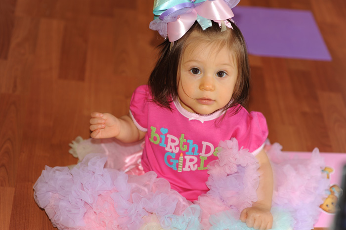birthday girl in all pink wearing tutu and hair bow
